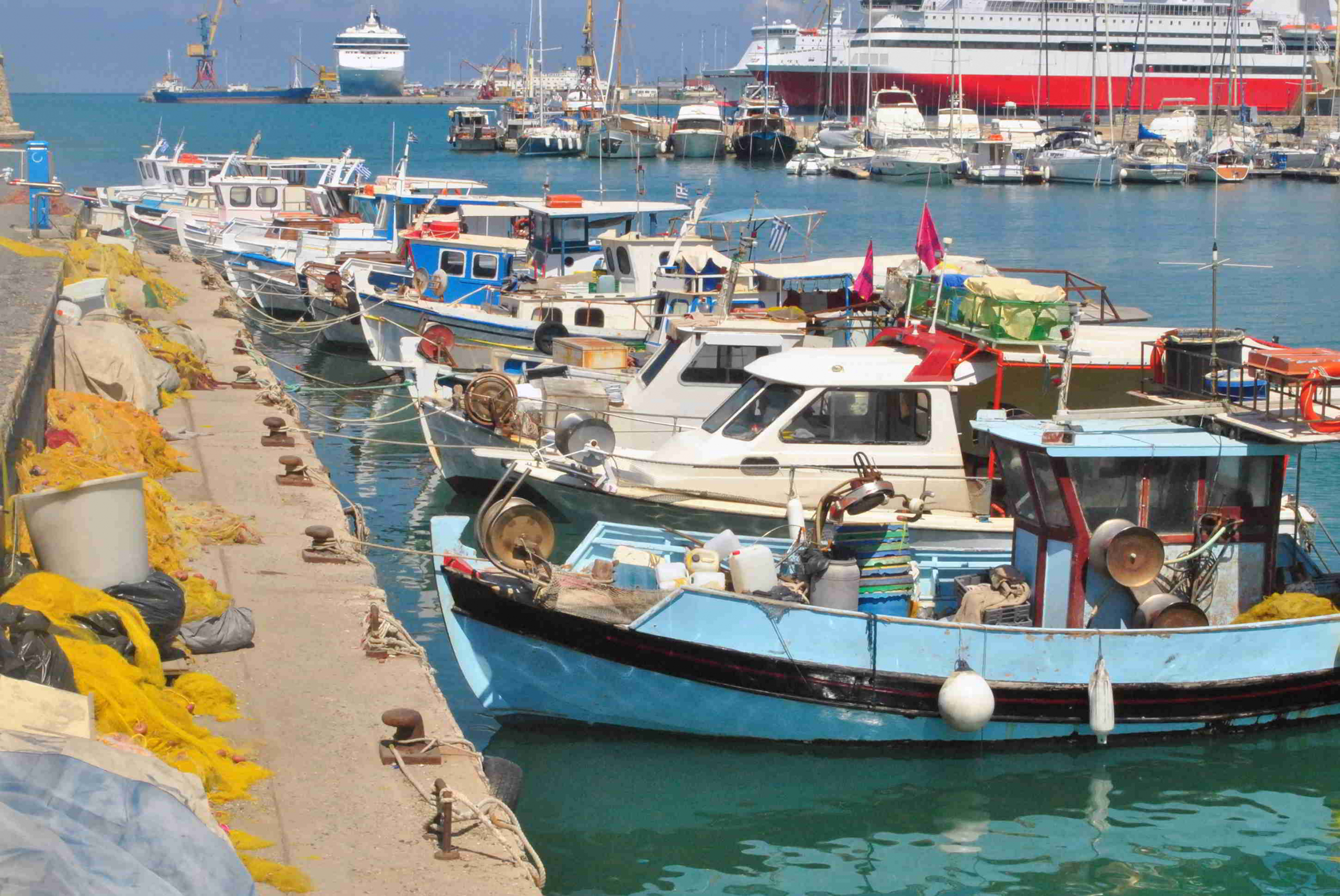 fishing boats and cruise ship in port