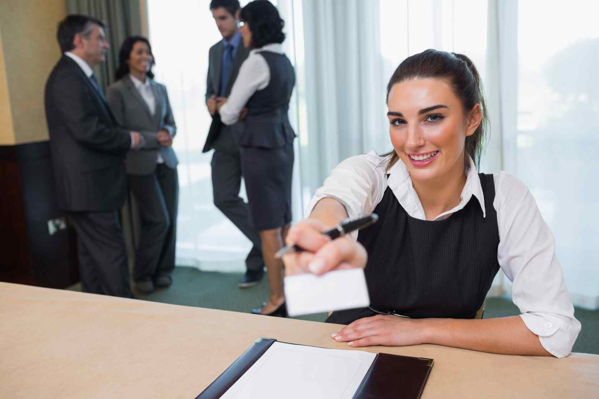 happy woman handing name tag